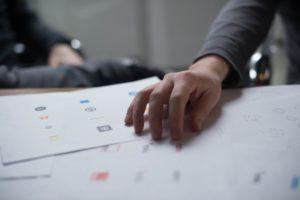 choosing a logo from dozens of printed logos