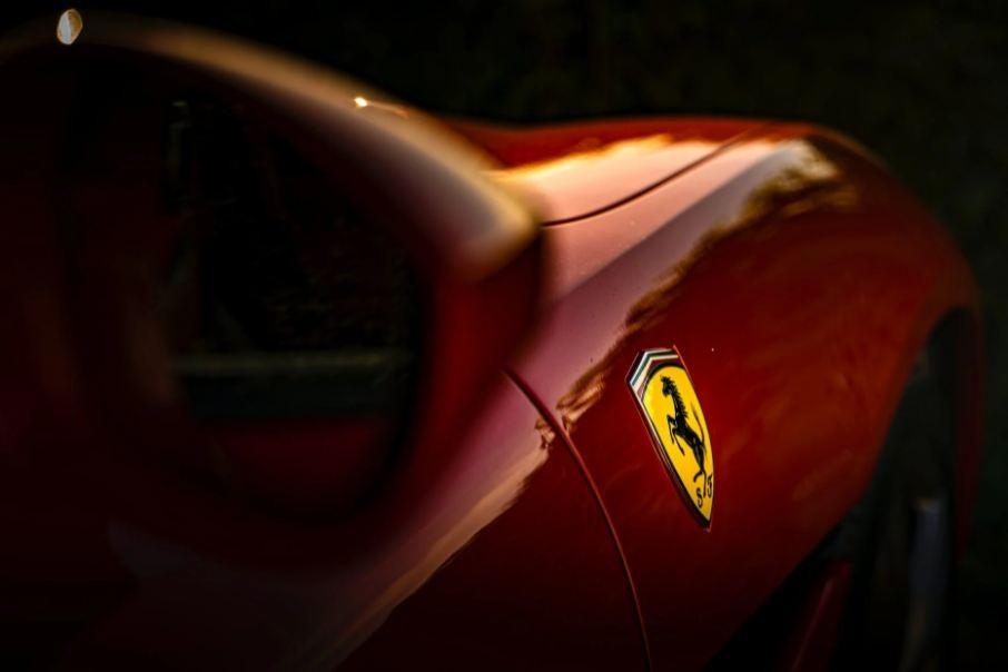 Selective Focus Photo of Ferrari Emblem
